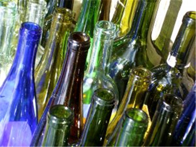 wine bottles to be filled by the semi auto liquid bottling m