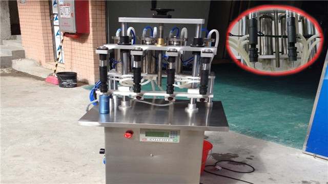 front view of the Semi automatic vacuum filling machine for